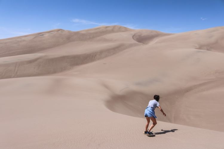 Sand boarding in Great Sand Dunes National Park, Colorado