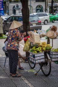 People selling fruit in Saigon - photo taken while traveling