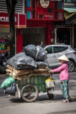Photograph of a street merchant in Saigon while traveling