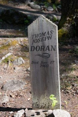 A tomb stone at an Old Gold Rush Cemetery in Skagway