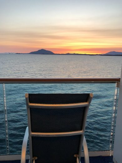 Watch the sunset from your balcony on a sea day
