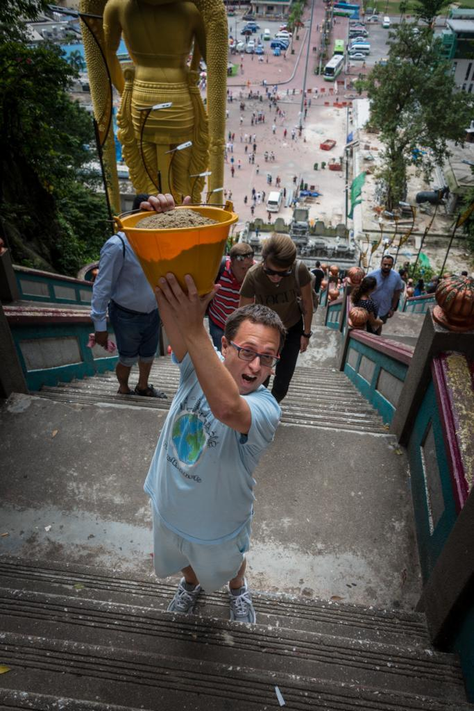 Rick Carrying a Bucket of Sand up to the Batu Caves