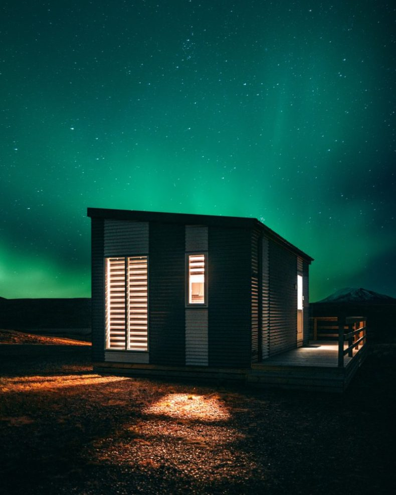 Northern Lights displayed over a cabin