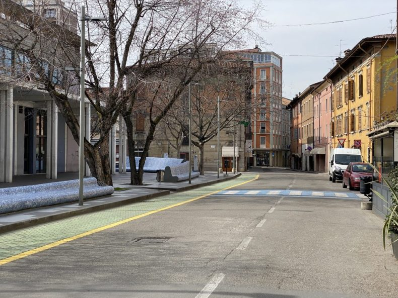 a deserted street in Italy at noon, after quarantine lockdown shelter in place
