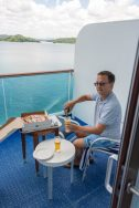 Rick Having Pizza and Beer on the balcony cabin on a cruise ship in the panama canal