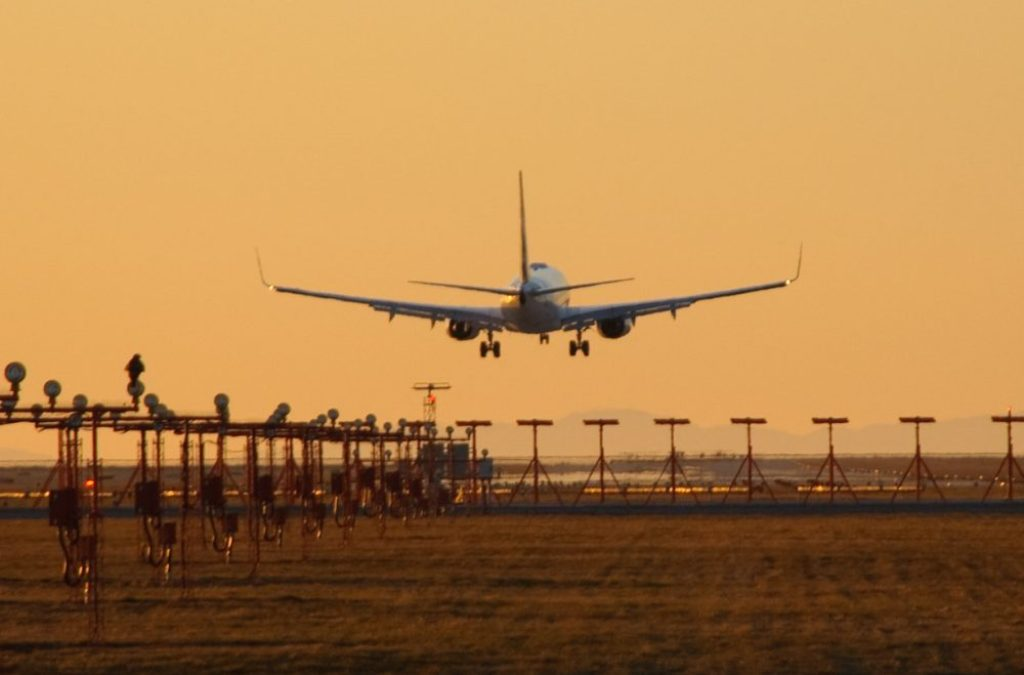 Plane landing at its destination - Will you be jet lagged on this flight?