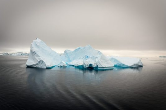 Cruising by a monster iceberg in Antarctica