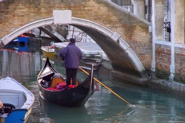 Image of Gondolier on one of the many Venetian canals, Venice,  Italy