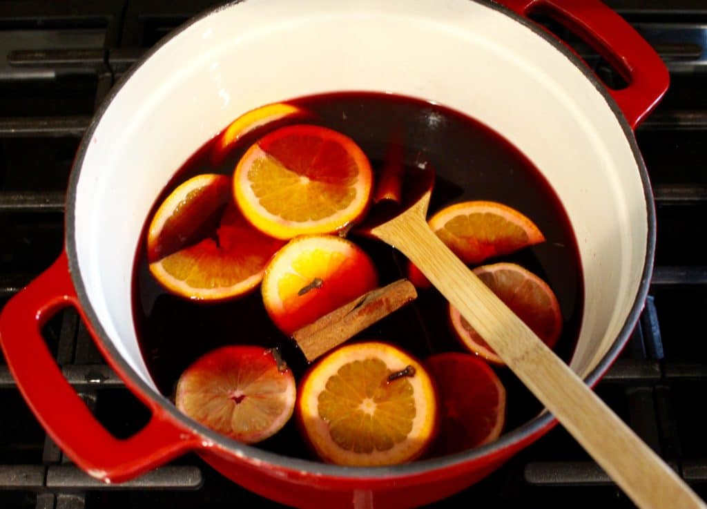 Glühwein is a traditional holiday drink in Germany that just tastes like Christmas. Basically, it's red wine, infused with the festive flavors of cloves, cinnamon, and citrus. It's served piping hot in a glass, and it's everything you need in your life. This Christmas drink recipe is perfect for holiday parties, or simply sitting by the fire. Try this traditional German glühwein recipe (mulled wine recipe) this holiday season!