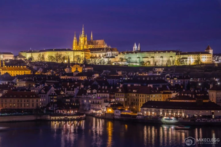 A view Prague Skyline at dusk from Old Town to the Lesser Quarter. Colorful Buildings and Prague Castle can be seen.