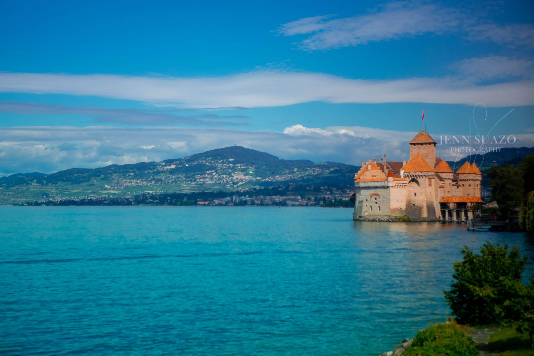 Castle Chilon on Lake Geneva with blue water and blue skies