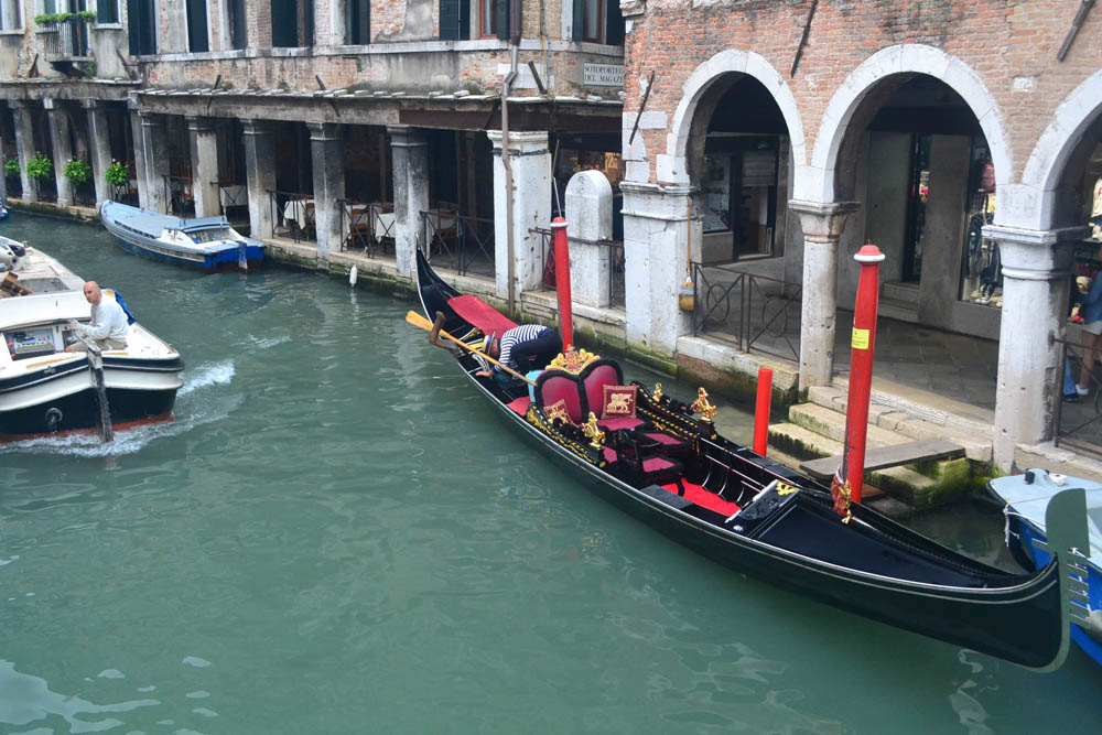 A gondola lies waiting for customers in Venice
