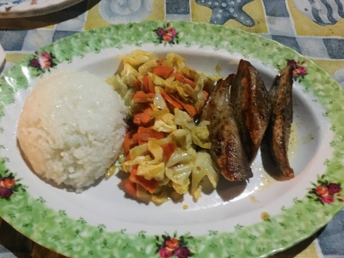 A typical meal at Village View: fresh fish, veggies and rice