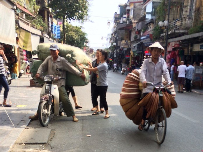 Motorbike with large sacks and bike with baskets, Hanoi, Vietnam