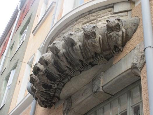 owl sculptures on building