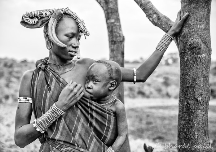 Mursi Woman Feeding Child