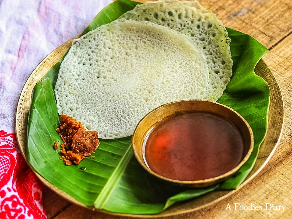 Authentic Assamese Food: Khulasaporir pitha with Laal Saah( Rice pan cake with Red Tea)