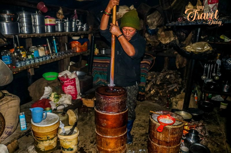 Brokpa woman making cheese, Tawang, Arunachal Pradesh. Visiting Brokpa settlements is one of the Offbeat experiences in Tawang