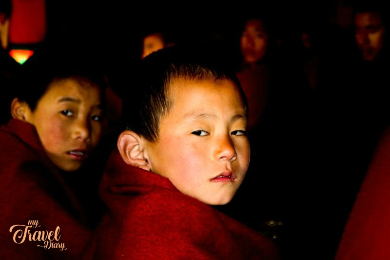 Little monks during the morning prayer session at Tawang Monastery, Arunachal Pradesh. Attending the morning prayer session is undoubtedly one of the  Offbeat experiences in Tawang, Arunachal Pradesh