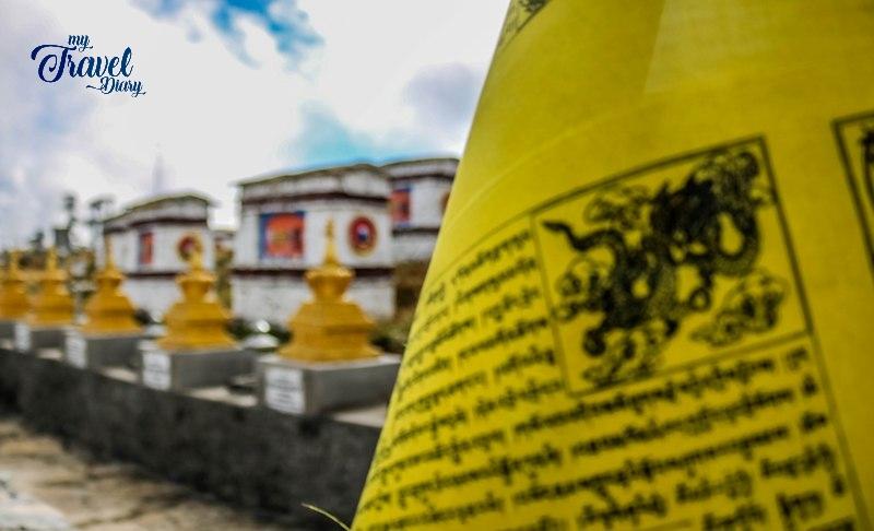 Buddhist Prayer Flag with stupas at Mandala Top