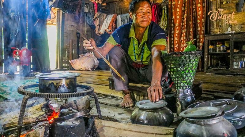 Adi Man during cooking in Ledum Village, Arunachal Pradesh