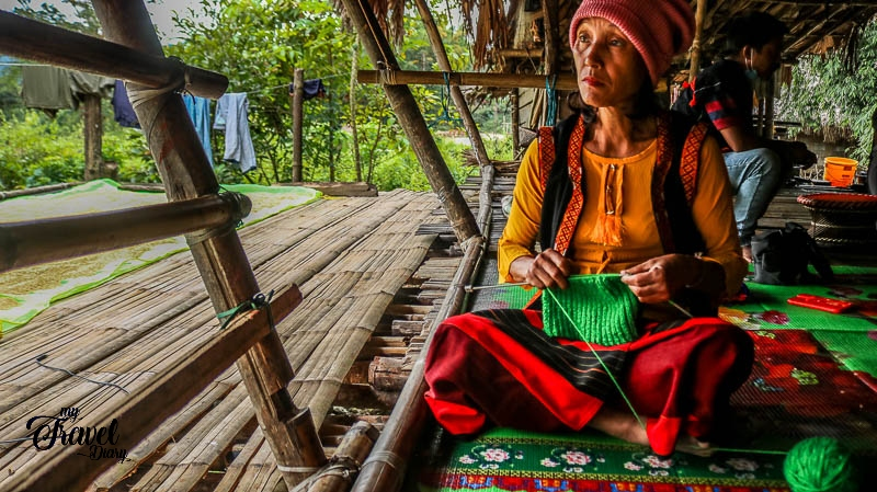 Adi woman in her house in Ledum Village_Arunachal Pradesh