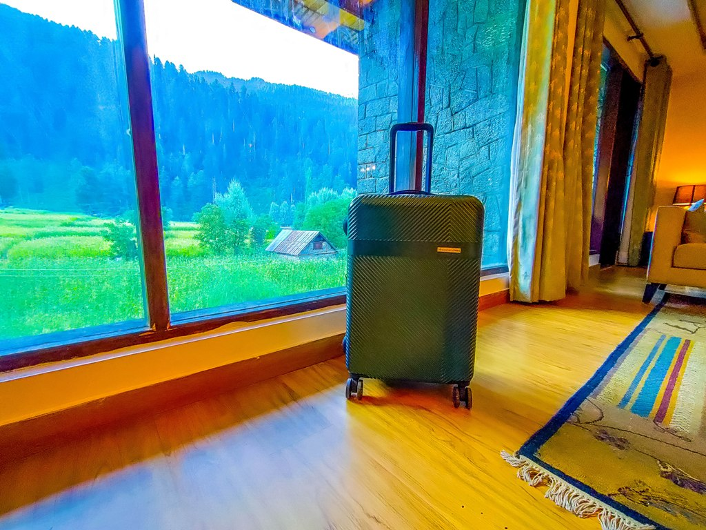 Nasher Mile suitcase in my suite in Sonmarg, Kashmir