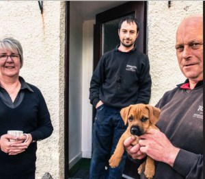 Allan Bartlett, the Tomatin Cooper, and His Family at the Tomatin whisky distillery in the Scottish Highlands