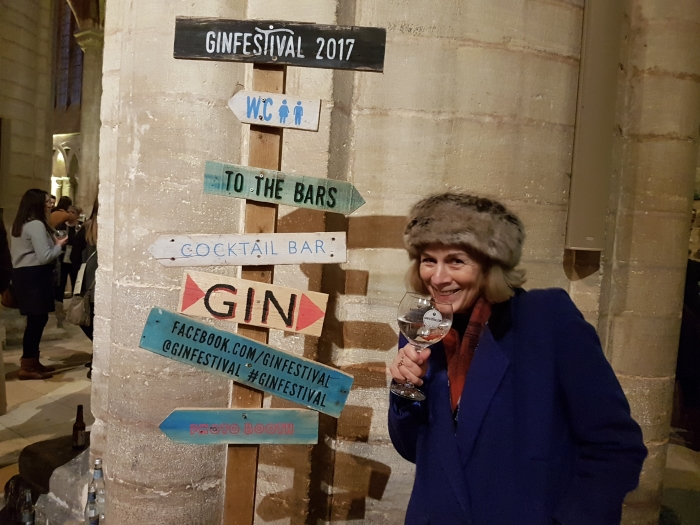 Signpost at the Peterborough Gin Festival with Donna Dailey drinking a gin and tonic