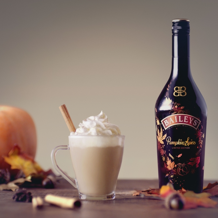 Baileys Pumpkin Spice Bottle and glass of Baileys chai cocktail