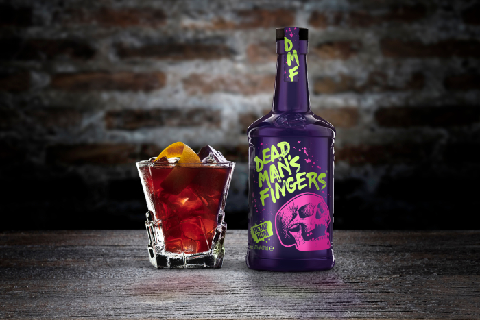 A bottle of Dead Man's Fingers CBD-infused Hemp Rum with a rum cocktail called Purple Haze.