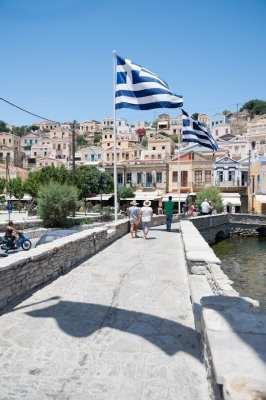Greek flag fluttering over Symi Greece