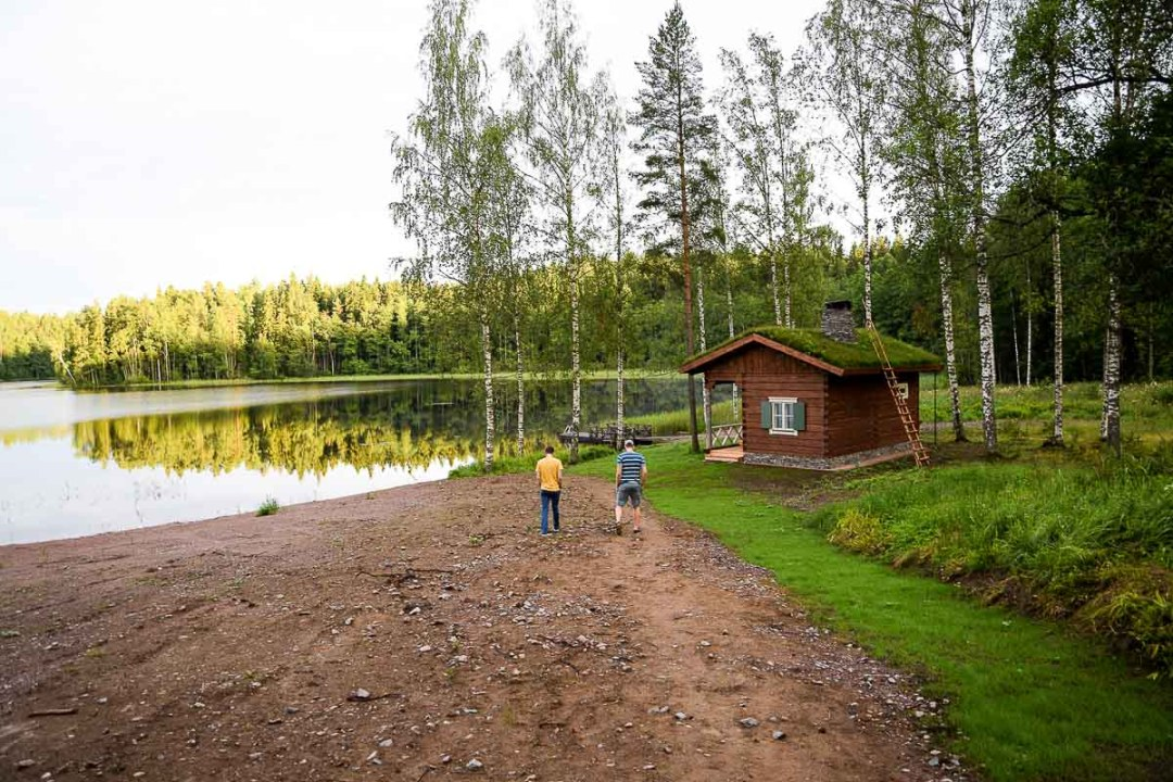 Two guys walking towards a lake