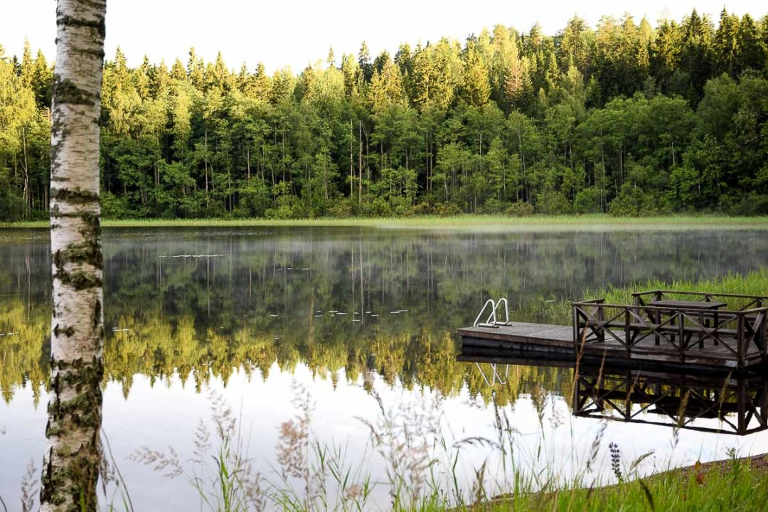 Dock on a lake with reflection of the trees
