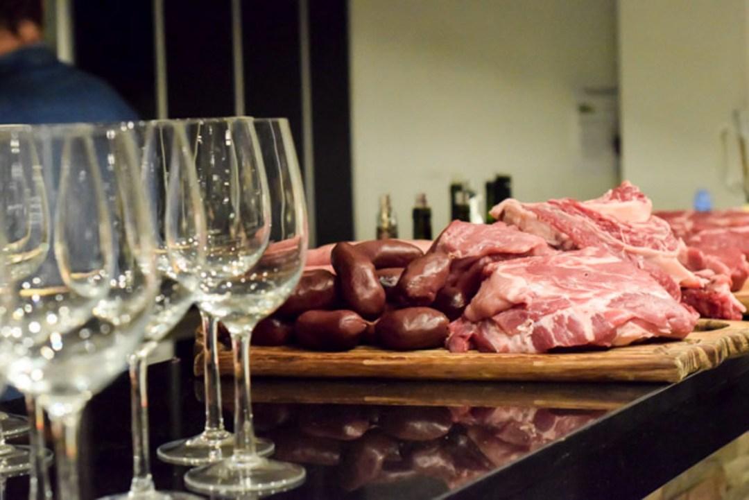 raw steak and empty wine glasses