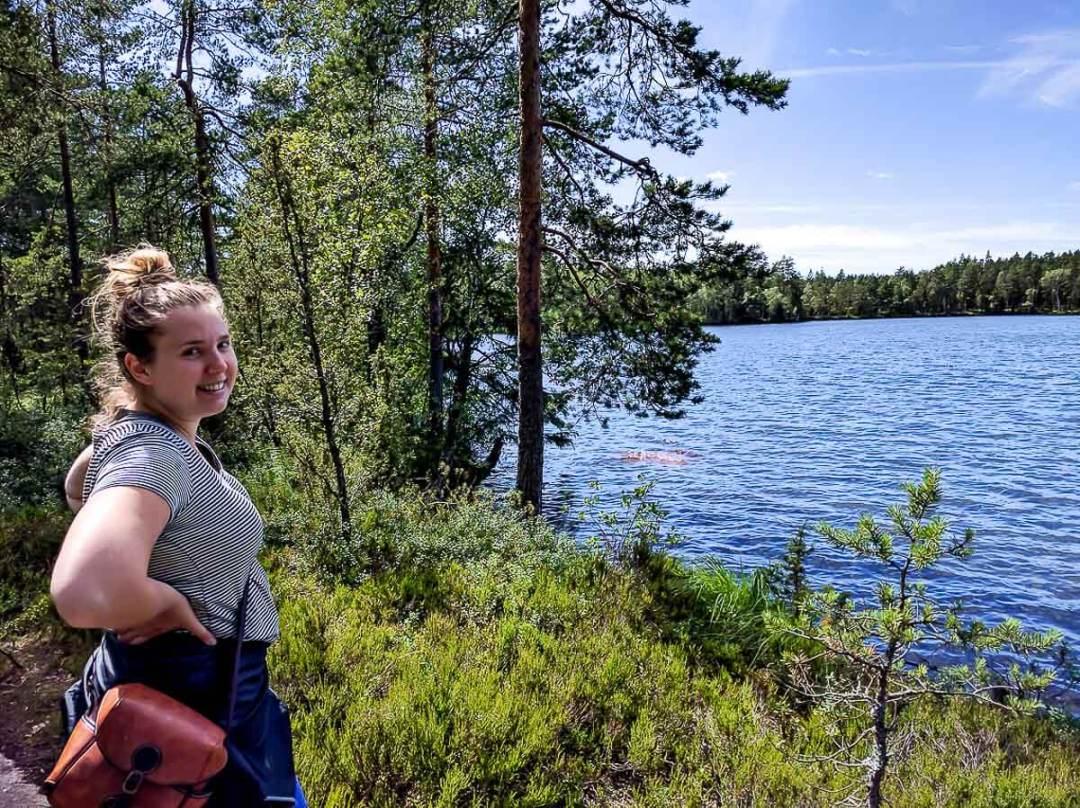 woman standing beside lake in Finland