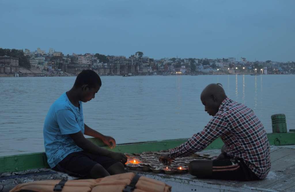 lighting flower ceremony on ganges river
