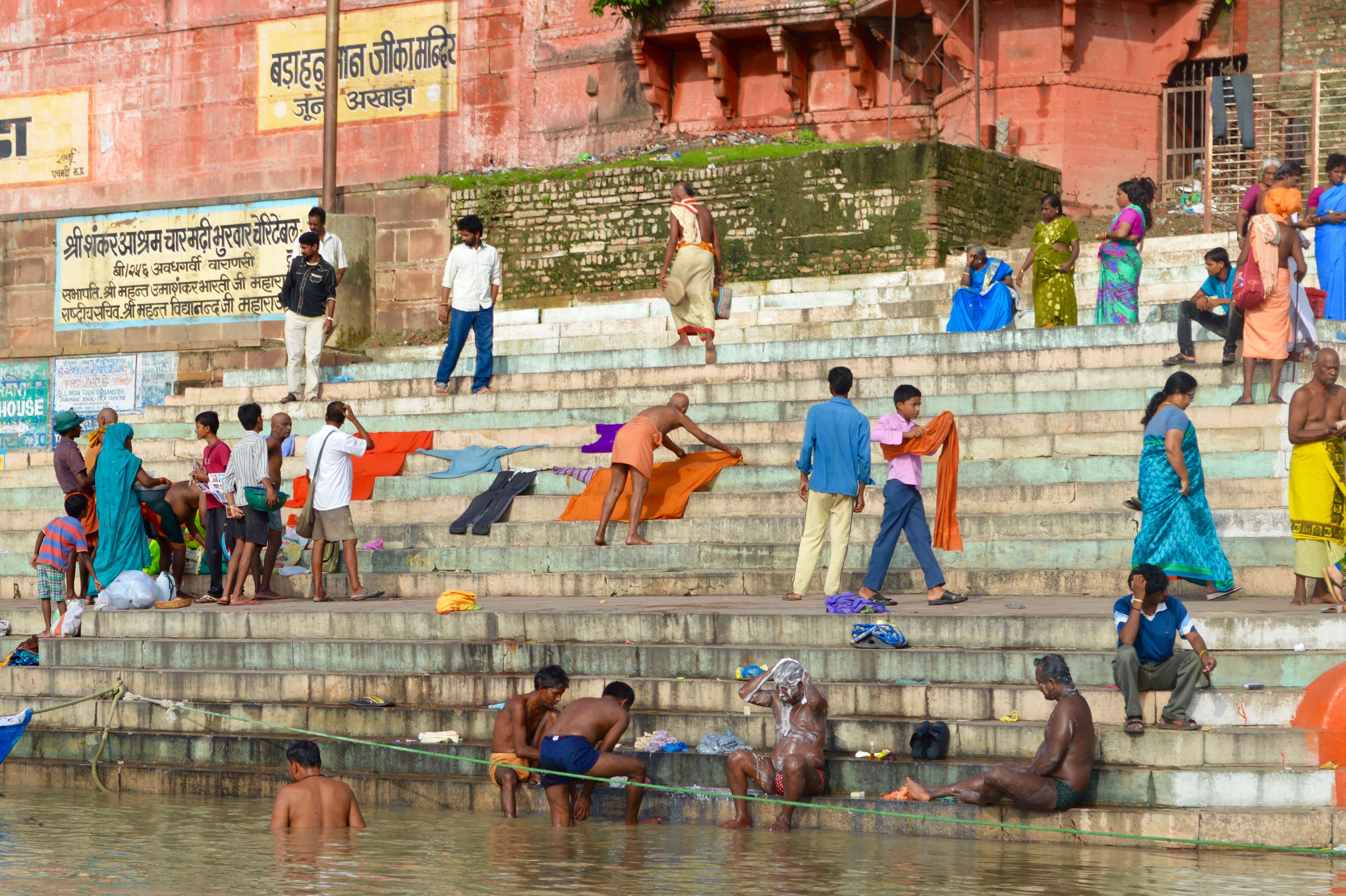 People washing clothes and living their everyday life on the edge of the Ganges River