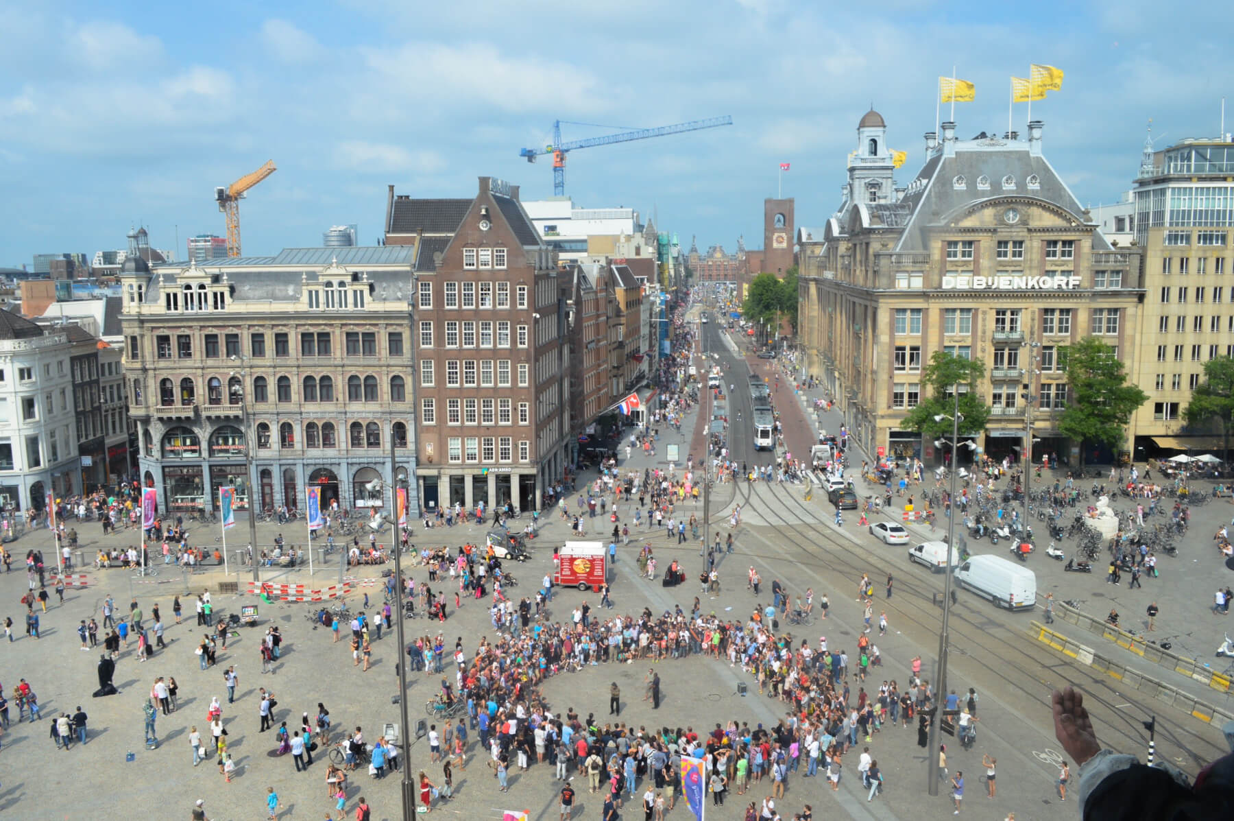 Dam Square in Amsterdam, with a huge circle of people in the middle