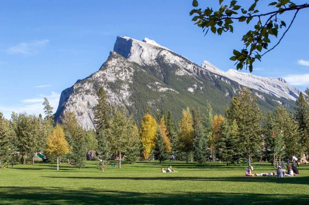 A point mountain peak behind a big park