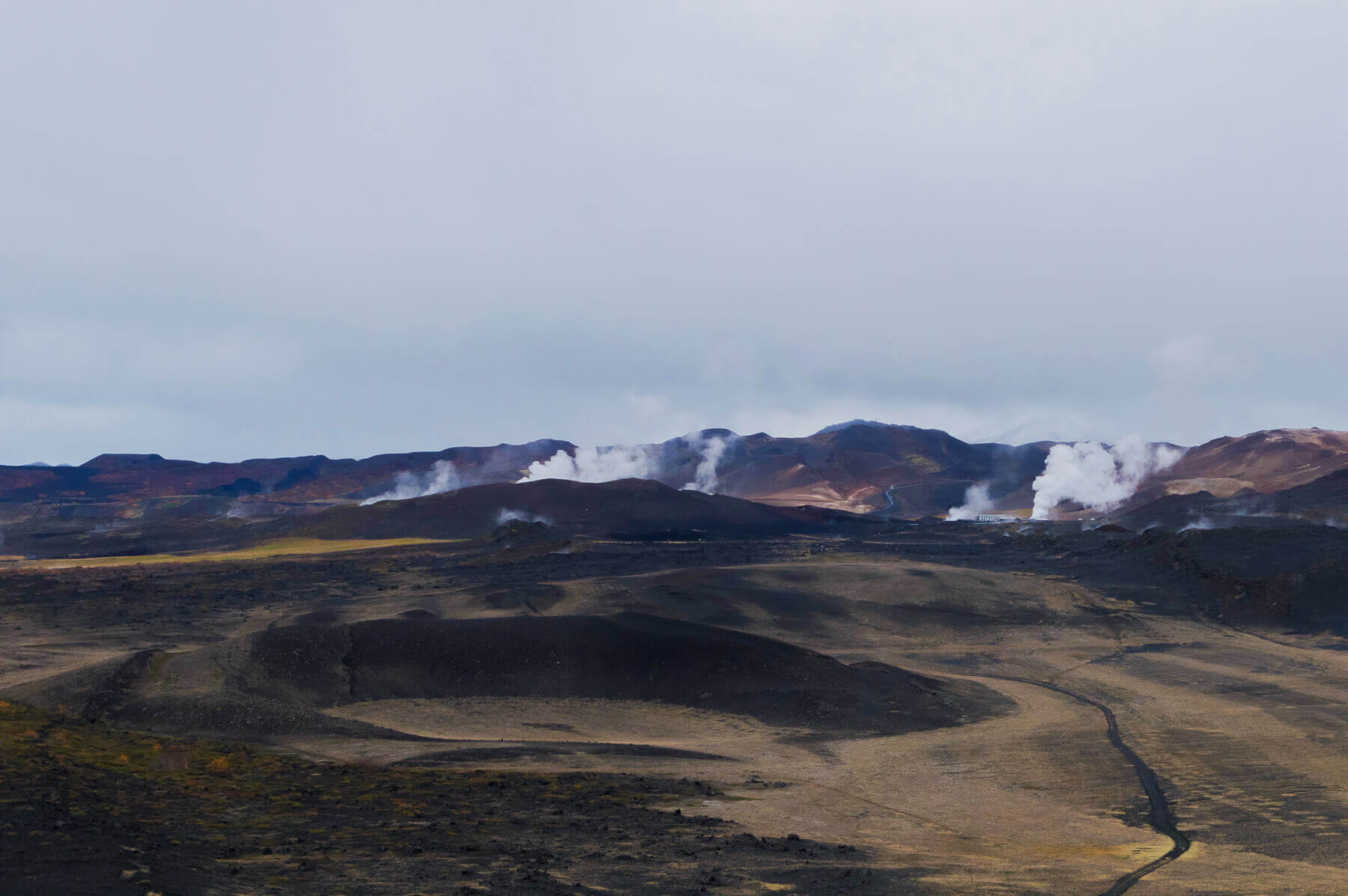 black volcanic crater with geothermal power