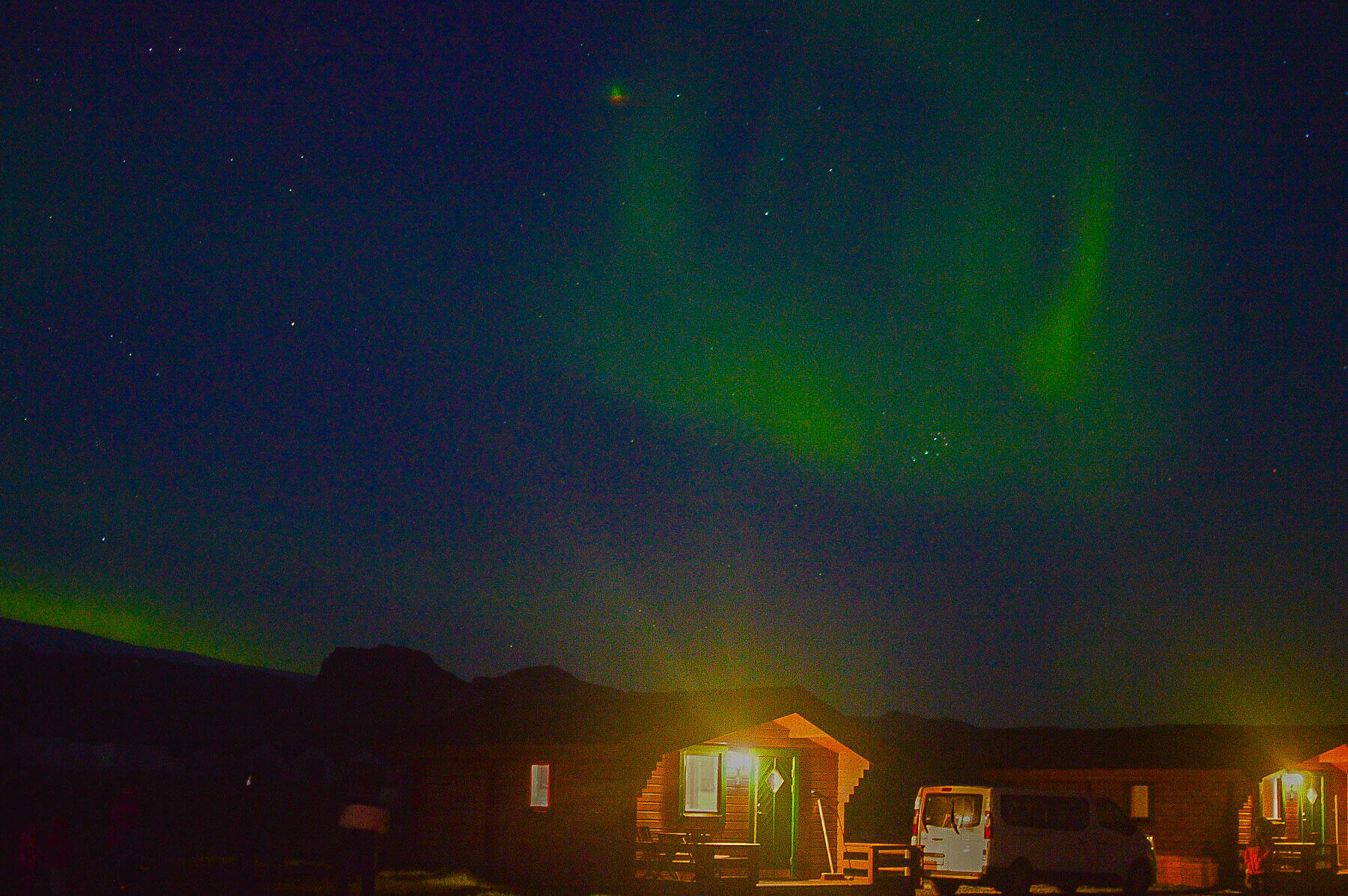 The northern lights above a cabin at night