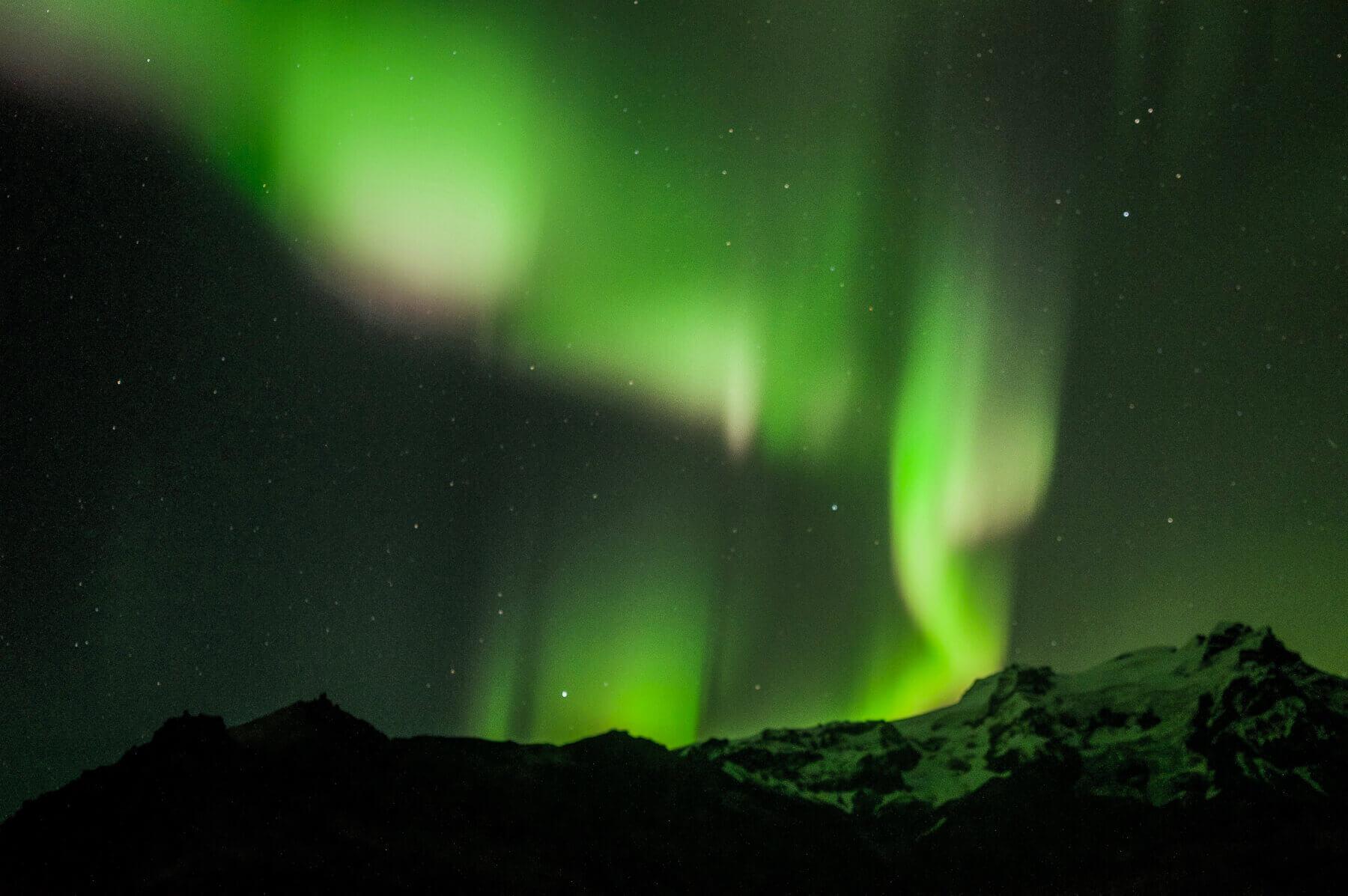 The Aurora Borealis streaming above the mountains