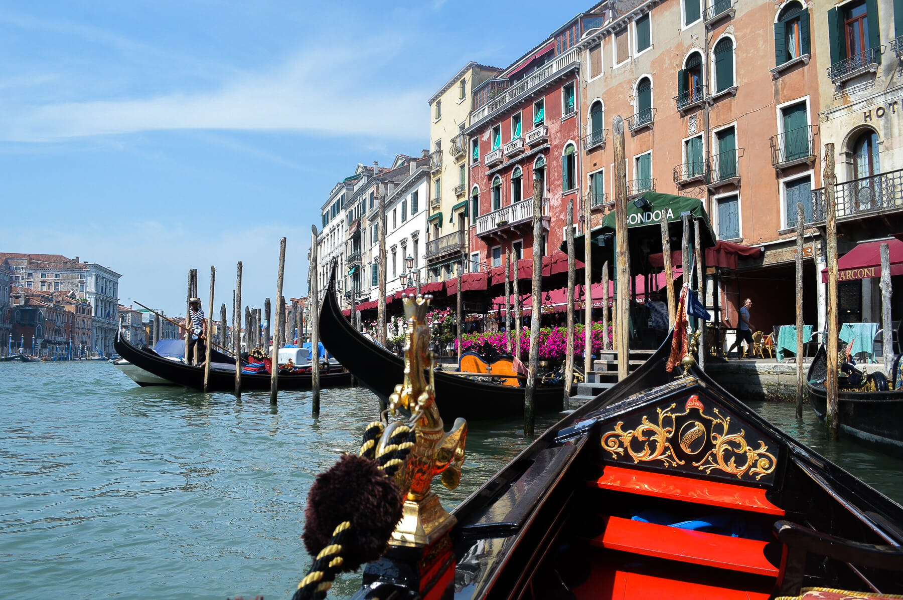 view from on venice gondola, looking into canal
