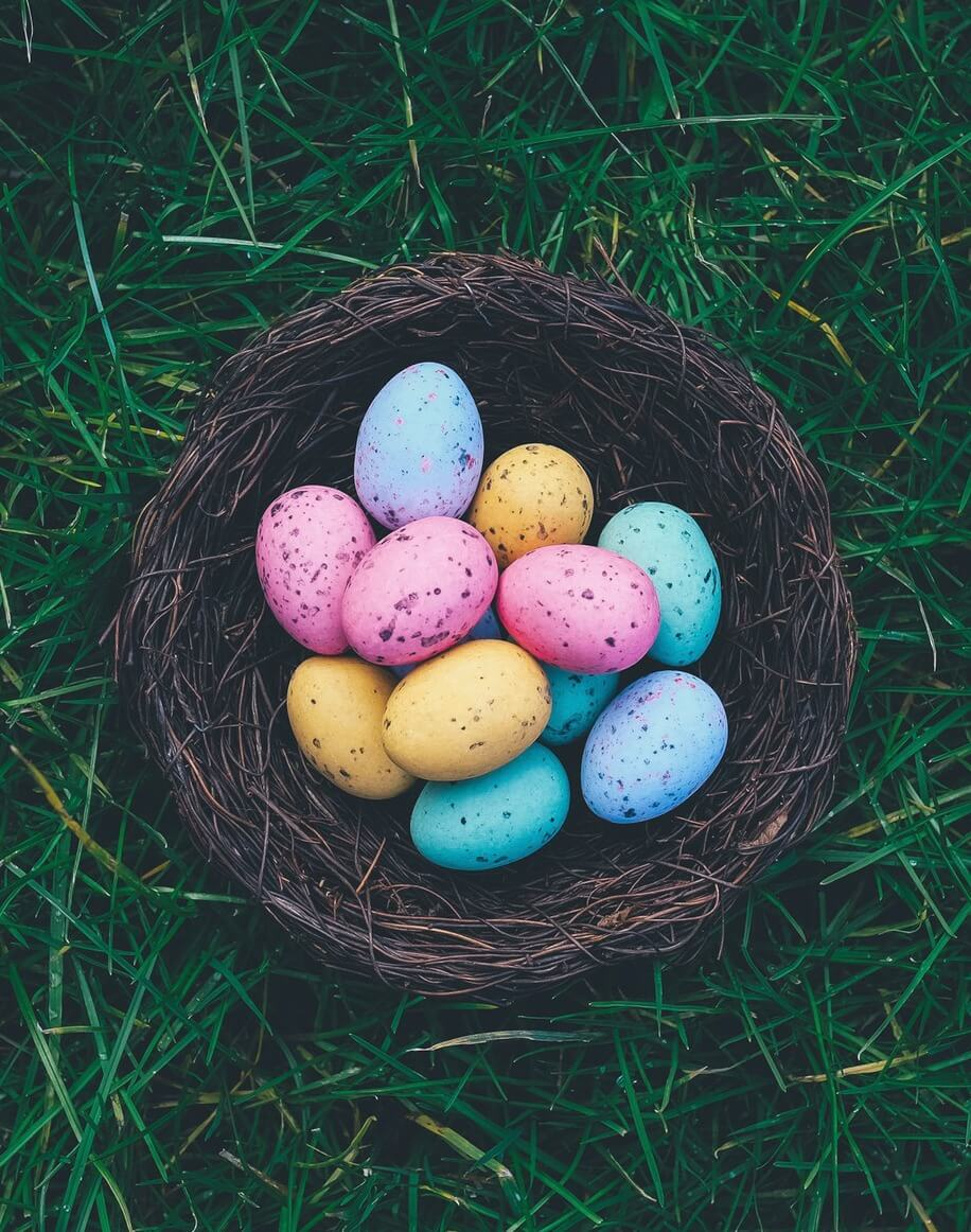 Colourful easter eggs in woven basket