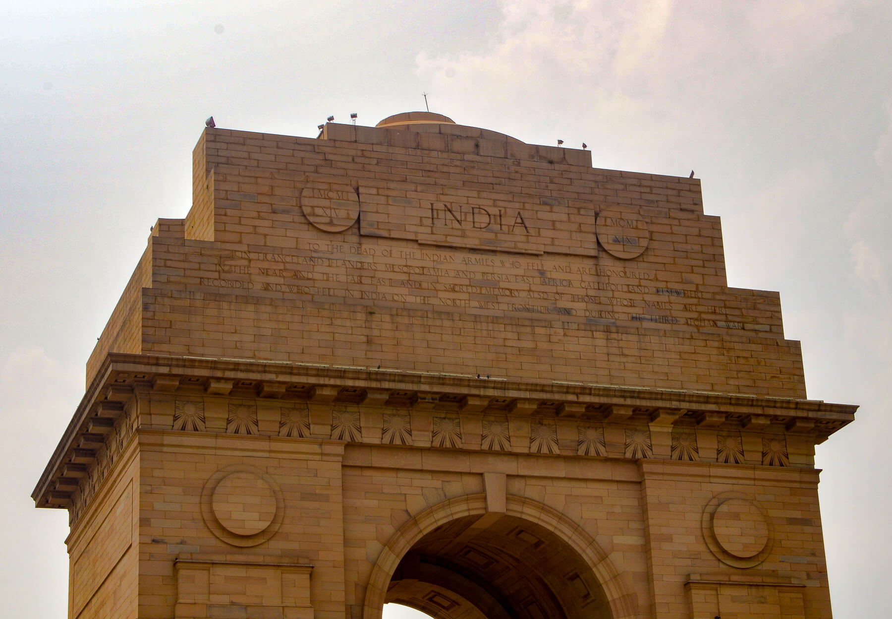"Golden Archway with ""India"" carved in the top"
