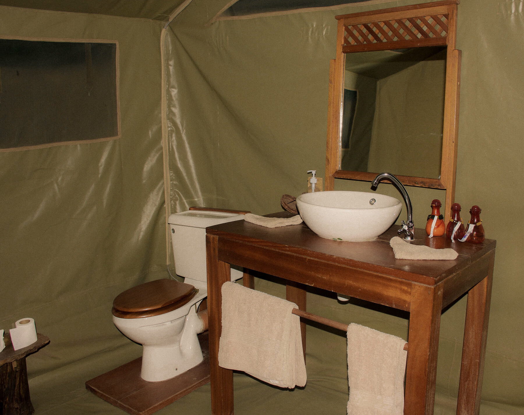 Losokwan camp tent ensuite - a vanity, toilet and towels