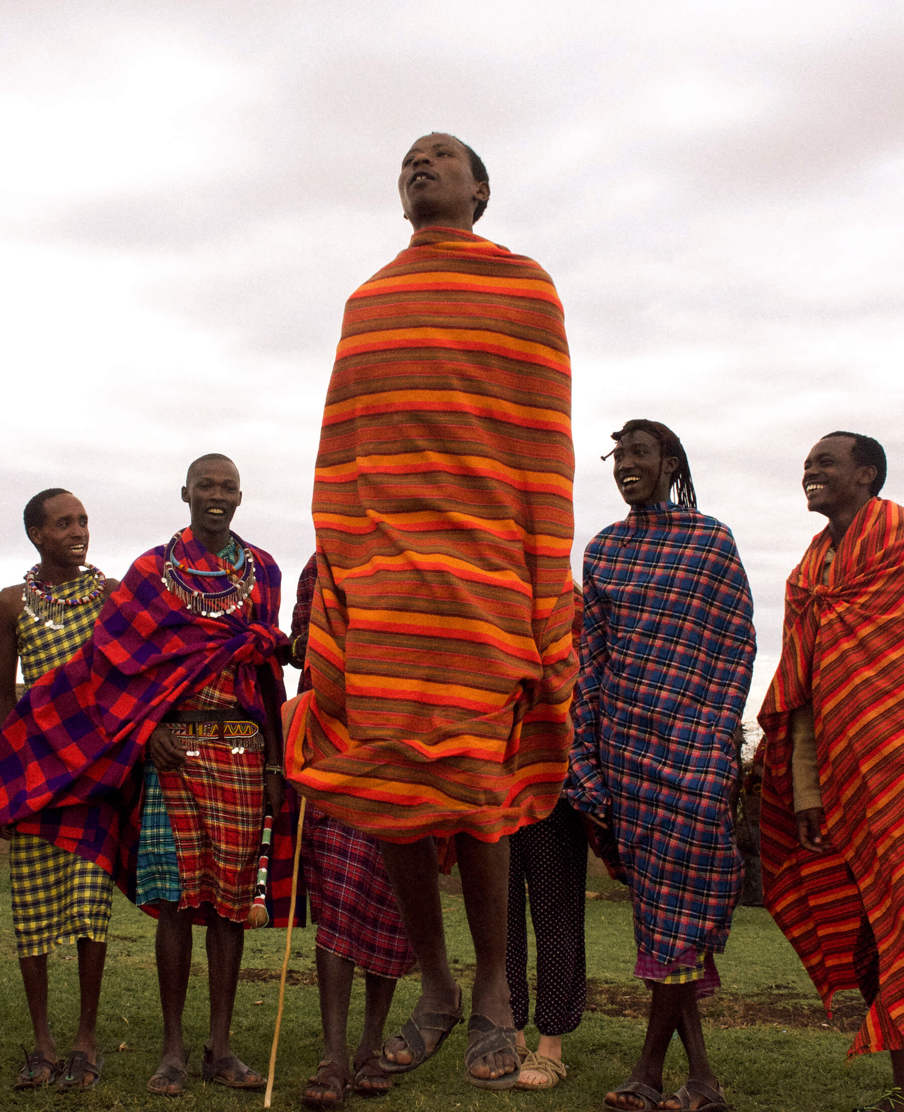 6 Maasai men demonstrating the Maasai dance - Highest jump wins the woman