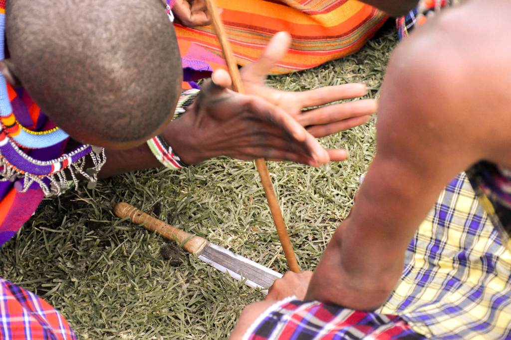 A demonstration of Maasai men making fire with a stick