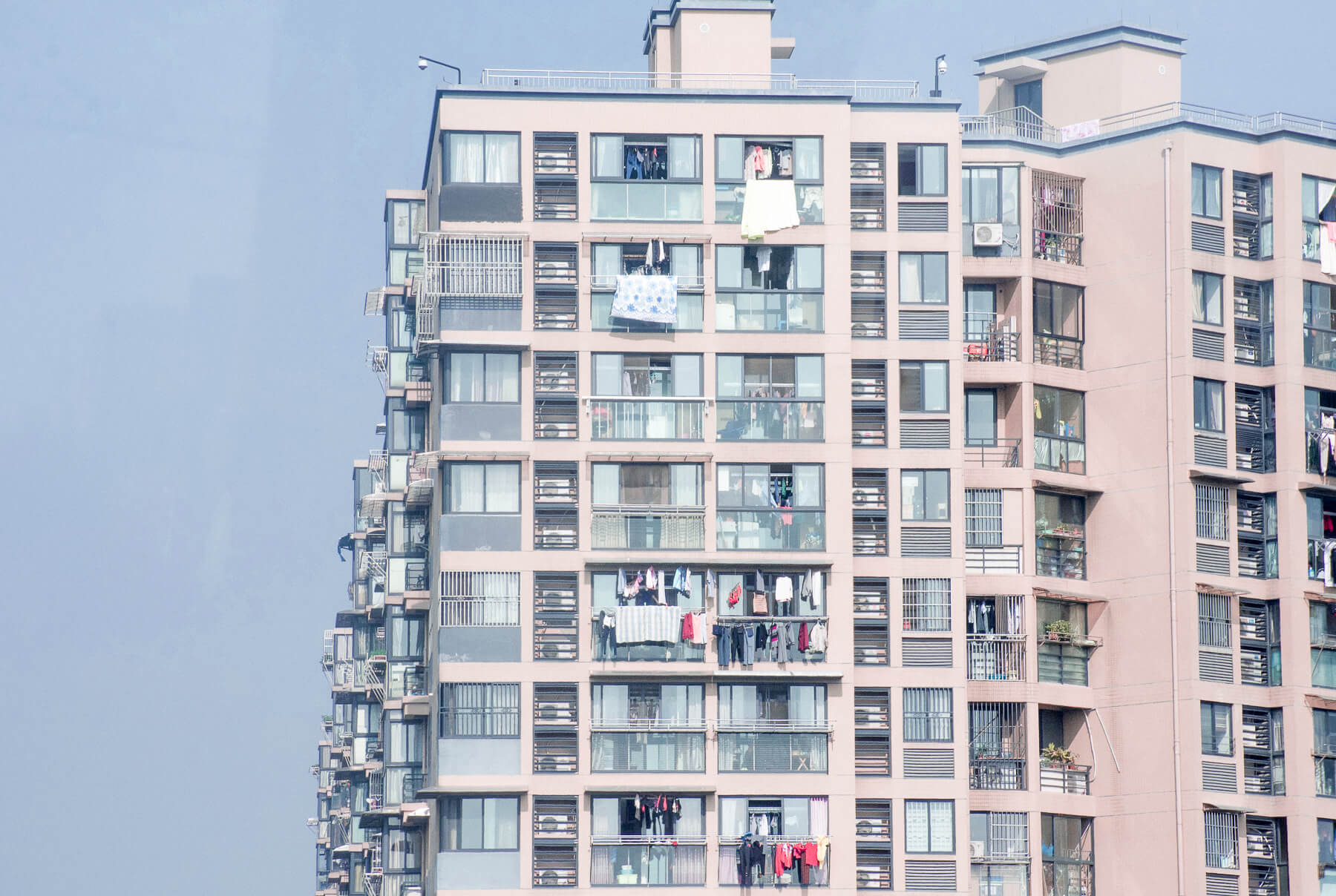 Tall highrise buildings in China with washing hanging over the balcony